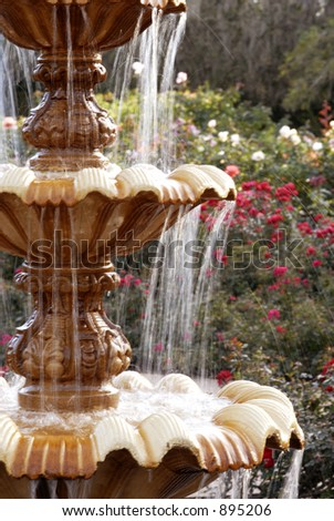 A fountain in a rose garden - stock photo
