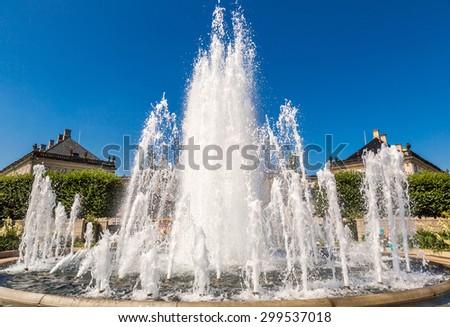 A fountain in the Amalie Garden and Amalienborg in Copenhagen, Denmark - stock photo