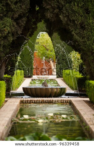 A fountain in the Generalife gardens of the Alhambra palace of Granada, Spain - stock photo