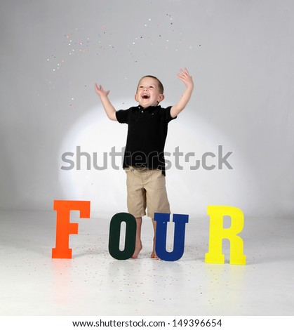A Four Year Old Boy Celebrates His Birthday - stock photo