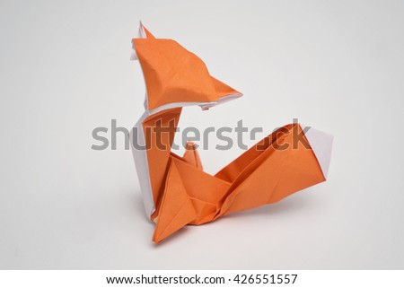 A fox origami with white background