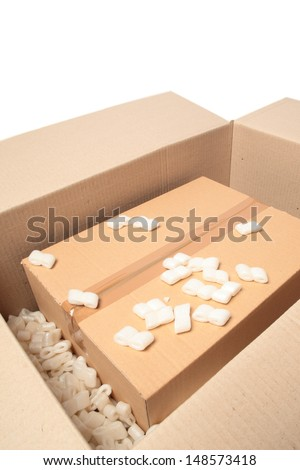 A fragile parcel being opened or packaged. - stock photo