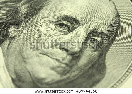 a fragment of a denomination of one hundred dollars with a portrait of Benjamin Franklin background - stock photo