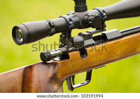 A fragment of a rifle with telescopic sight - stock photo