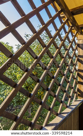 A fragment of a wooden summerhouse - stock photo