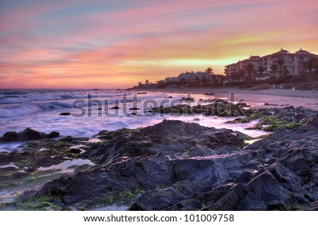 A fragment of Cabopino beach,Coasta del Sol surprised at sunset in very beautiful colors. - stock photo