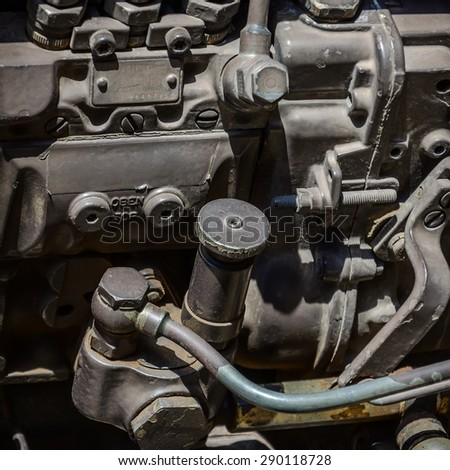 A fragment of the engine of tractor - stock photo