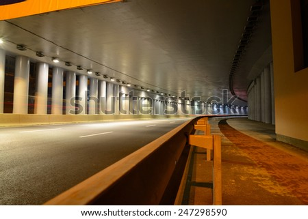 A fragment of the motorway tunnel footpath - stock photo