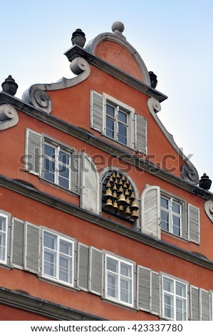 A fragment of the old facade of the building. A window is decorated with lots of bells. Lindau, Bavaria, Germany. - stock photo