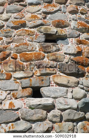 A fragment of the old walls of the monastery tower. Architecture, exterior, background