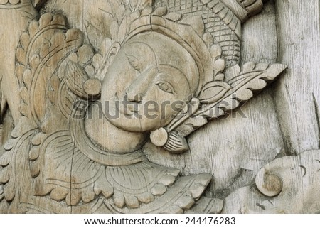 a fragment of the old wooden panels on a mythological theme