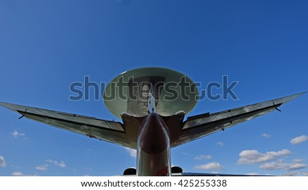 A fragment of the plane antenna against the sky in flight - stock photo