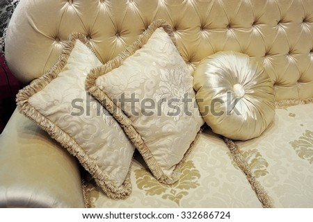 a fragment of the sofa with pillows - stock photo