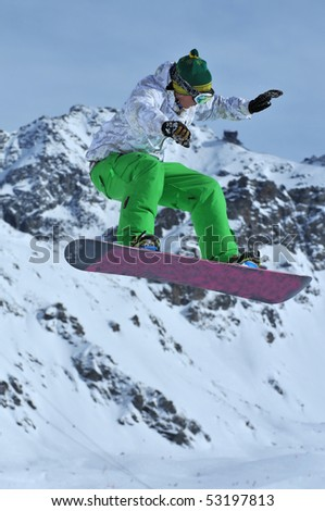 a freestyle snowboarder performing a jump - stock photo