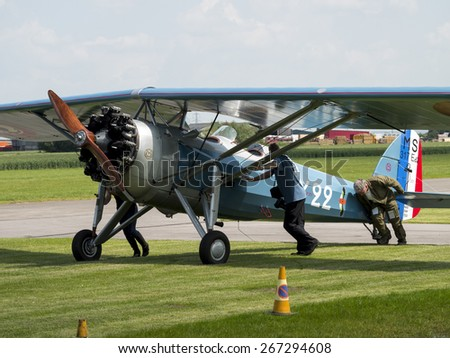 a French built 1930s Morane Saulnier biplane aircraft at Breighton airfield,yorkshire,UK.taken 14/07/2013 - stock photo