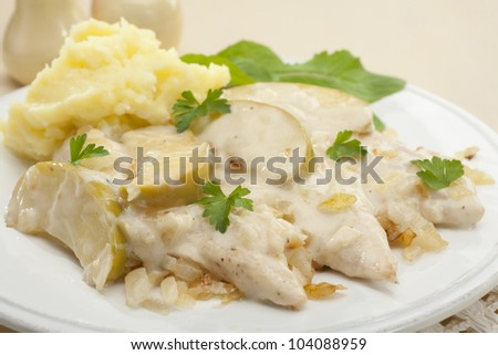 A French dish, Normandy chicken is seasoned with nutmeg and cooked with apples and onions in a cream and cider sauce. Here it is served with mashed potato.