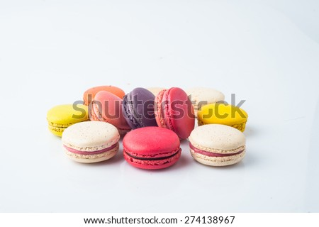 A french sweet , colorful macaroons  closeup.  on white background