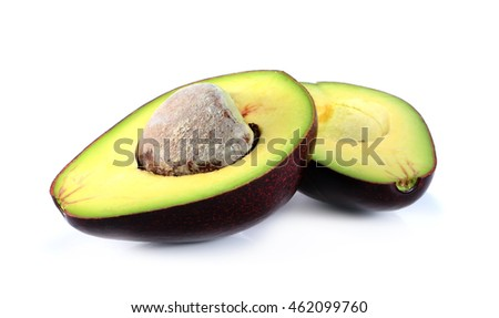A fresh avocado cut in half on white background
