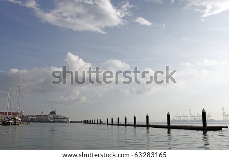 A fresh calm morning at a luxury boat marina. - stock photo
