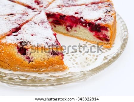 a fresh cherry charlotte cake on a glass tray - stock photo
