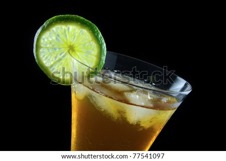 A fresh drink with a slice of lime - stock photo