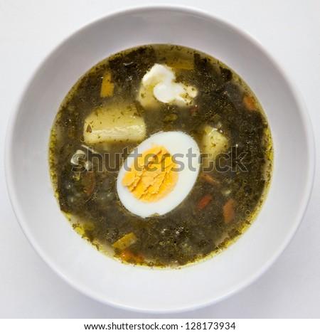 A fresh green soup with spinach sorrel egg potato - stock photo