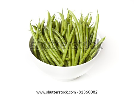 A fresh green string bean against a white background - stock photo
