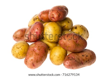 a fresh raw potatoes on a white background