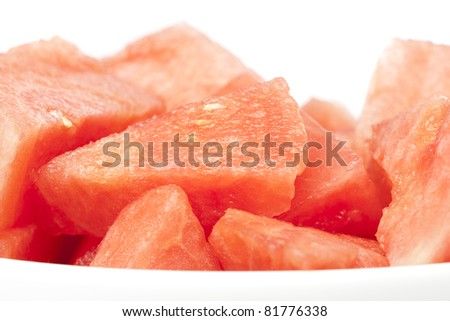 A fresh ripe watermelon isolated against a white background