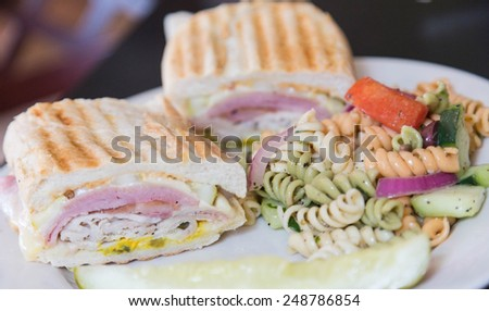A fresh toasted cuban sandwich with pasta salad - stock photo