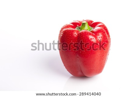 a fresh vivid red sweet pepper(pimenta, bell pepper, pimento) close up isolated white at the studio.