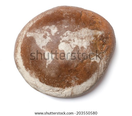 A freshly baked loaf of bread covered with rye flour in the shape of the world.(series) - stock photo