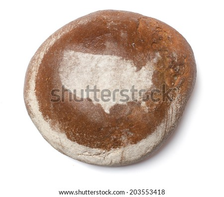 A freshly baked loaf of bread covered with rye flour in the shape of USA.(series) - stock photo