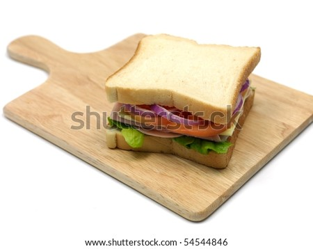 A freshly made ham sandwich on a kitchen bench