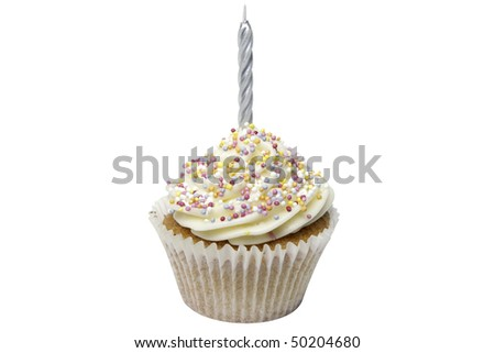 A freshly made homemade cupcakes with a candle in the buttercream.  Isolated on white with an accurate clipping path.