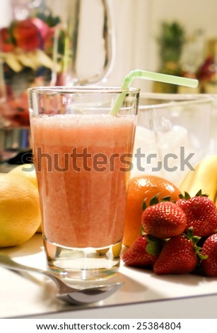 A freshly prepared fruit smoothie in the kitchen.