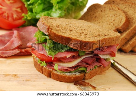 A freshly prepared roast beef and swiss cheese sandwich