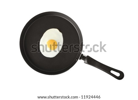 A fried egg  in a frying pan - stock photo
