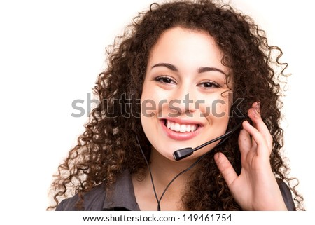 A friendly asian telephone operator smiling isolated over a white background - stock photo