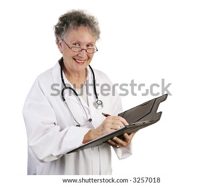 A friendly, mature female doctor making a note in a patient's chart.  Isolated on white.