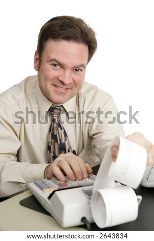 A friendly smiling accountant working on his adding machine.  Isolated on white. - stock photo
