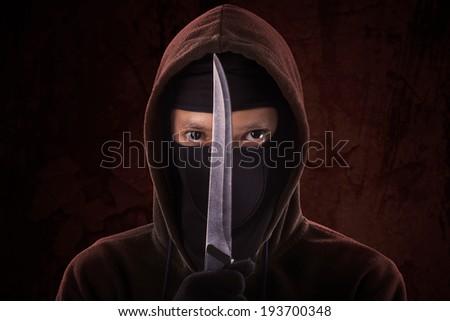 A frightening man holding sharp knife - stock photo