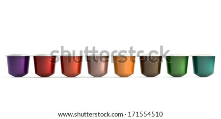 A front view of a collection of colorful instant espresso coffee capsules sealed with foil in a neat line on an isolated white background - stock photo