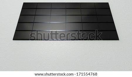 A front view of a wall 30 stacked flat screen televisions mounted on a light colored wall background - stock photo