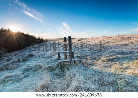 A frosty wooden stile on a winter morning on Bodmin Moor in Cornwall - stock photo
