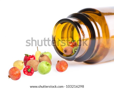 a fruit and vegetables in bottle like vitamins, on white, macro - stock photo