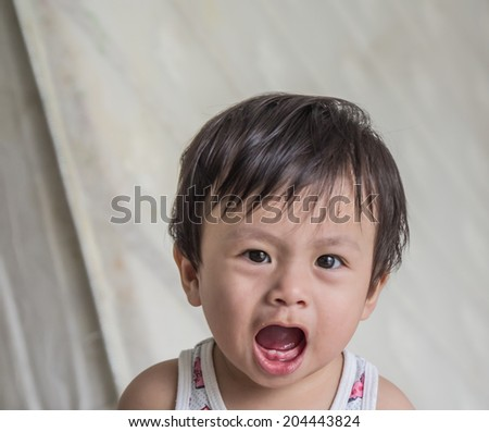 A frustrated and angry young boy - stock photo