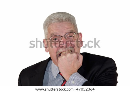 a frustrated caucasian senior manager biting into his fist, isolated on white background