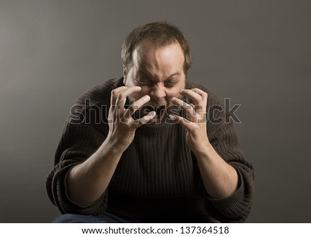 A frustrated single man is angry and emotional, screaming with an open mouth - stock photo