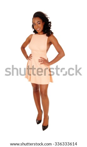A full body image of a african american women with her hands on her hips standing in front, isolated for white background.  - stock photo